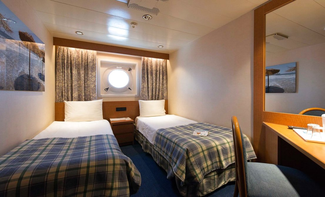 Celestyal Olympia cruise ship - Category XA - Exterior Stateroom - short cruise in Greece and Turkey - Cruises in Greece - Greek cruises - Greek Travel Packages - Cruise Greek islands - Travel to Greek islands - Tours in Greece - Atlantis Travel Agency in Athens Greece