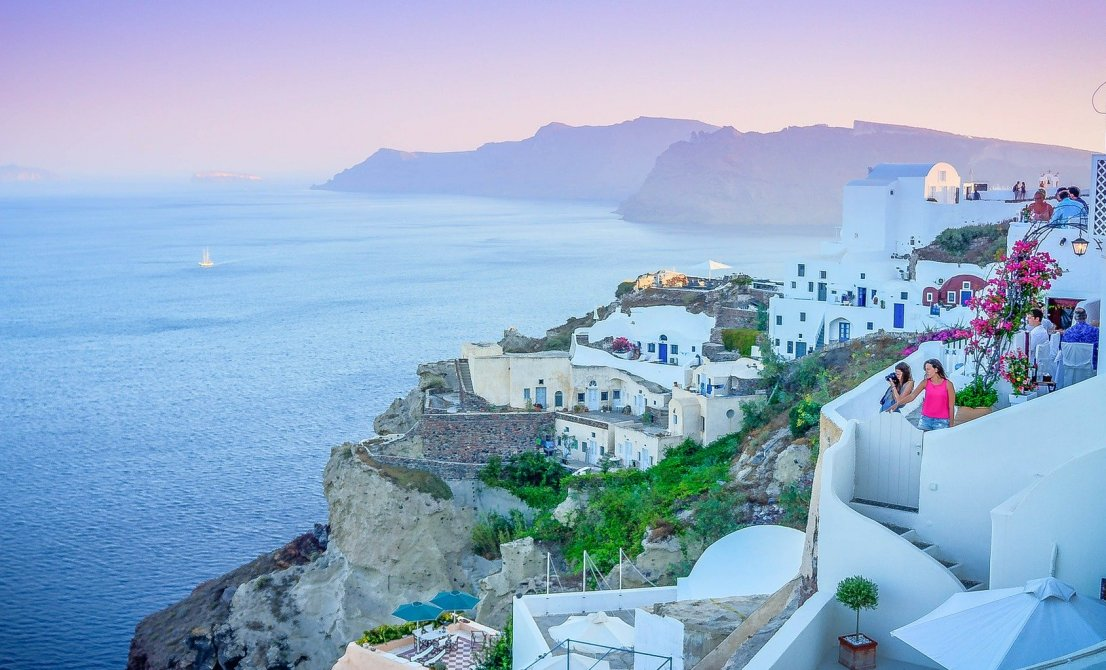 Santorini Greece - sunset in Oia - Cruises in Greece - Greek cruises - Greek Travel Packages - Cruise Greek islands - Travel to Greek islands - Tours in Greece - Atlantis Travel Agency in Athens Greece