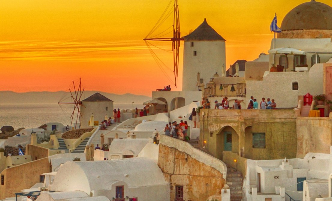 Santorini Greece - windmills under the sunset - Cruises in Greece - Greek cruises - Greek Travel Packages - Cruise Greek islands - Travel to Greek islands - Tours in Greece - Travel Agency in Greece